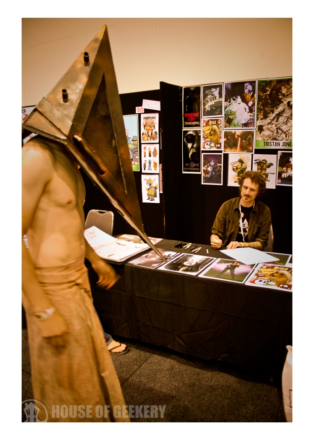 Silent Hill artist T-Rex Jones meets Pyramid Head.